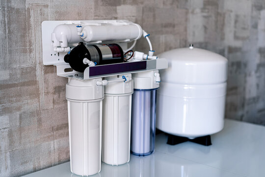 Household filtration system. Water treatment concept. Use of water filters at home. Special technic for home.