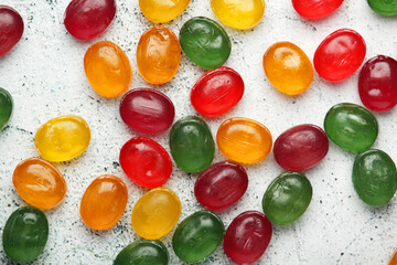 Bright candy sweets on white background