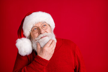 Close up photo minded brainstorm creative old retired man pensioner in santa headwear look copyspace touch chin hand think x-mas wish gifts wear shine jumper isolated bright color background Wall mural