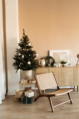Photo sur Aluminium Fleur Modern home interior design concept. Comfortable cozy living room decorated with Christmas tree with gifts, rattan chair. Christmas / New Year celebration decorations.