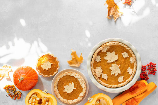 Sunny autumn day pumpkin pie baking at home concept
