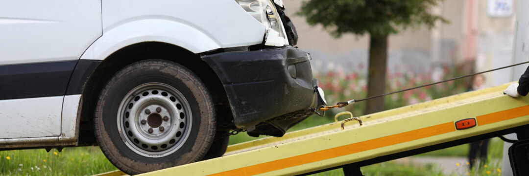 Wrecked car drives into tow truck. Service evacuation concep