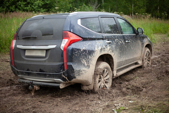 The wheels of the car are stuck in the mud. Off-road driving.