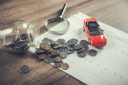 car insurance with coin on document