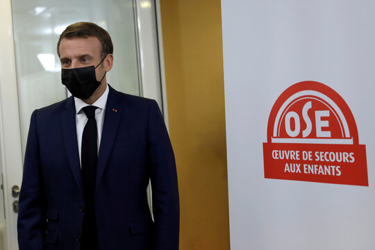 French President Emmanuel Macron arrives to meet volunteers of the association OSE, which takes care of sick and disabled children in Paris