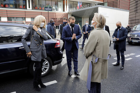 French President Emmanuel Macron and his wife Brigitte Macron arrive to meet volunteers of the association OSE, which takes care of sick and disabled children in Paris