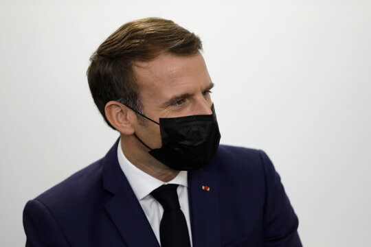French President Emmanuel Macron listens to volunteers of the association OSE, which takes care of sick and disabled children in Paris