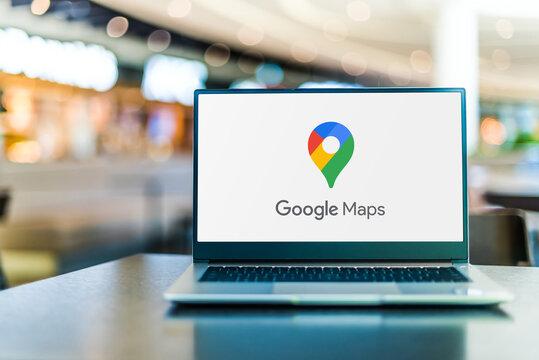 Laptop computer displaying logo of Google Maps