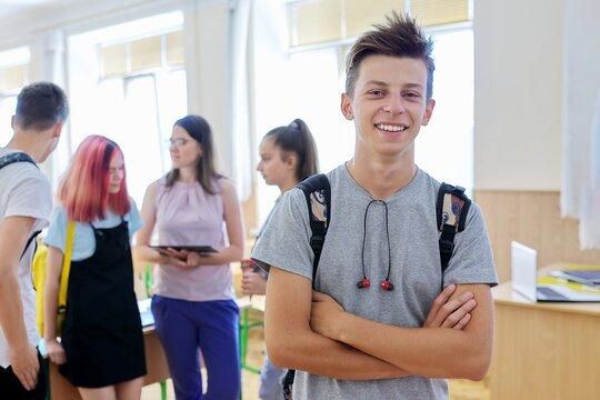 Portrait of smiling teenage boy in class on break