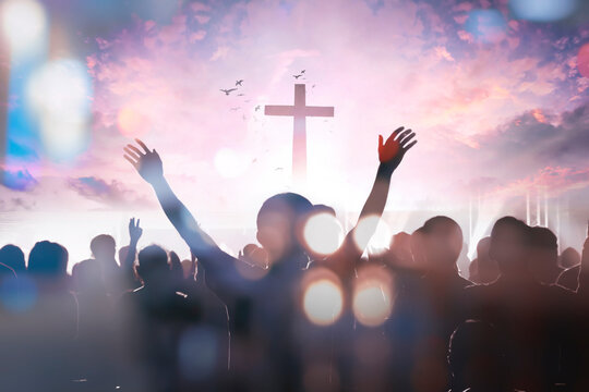 christian people group raise hands up worship God Jesus Christ together on cross over cloudy sky background