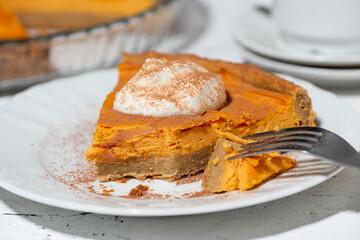 piece of sweet pumpkin pie with cream