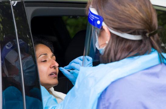 Coronavirus nasal swab test, Asian woman in UK