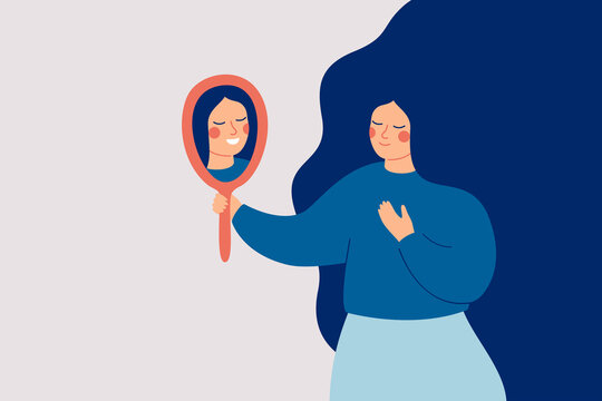 Young woman looks at the mirror and sees her happy reflection. Self-acceptance and confidence concept.