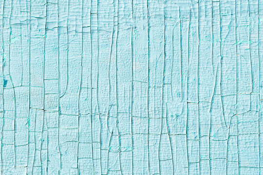 texture of blue old paint on a wooden surface