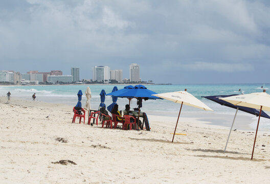 Tourists are seen at a beach as Hurricane Delta approaches, in Cancun
