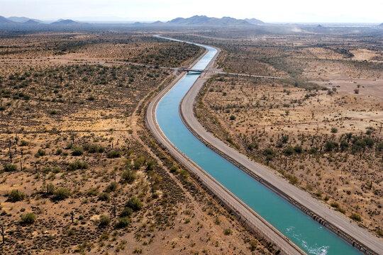 Irrigation canal winding thru the Arizona desert