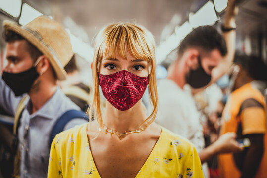 Woman wearing mask travelling in the subway during covid-19 pandemic