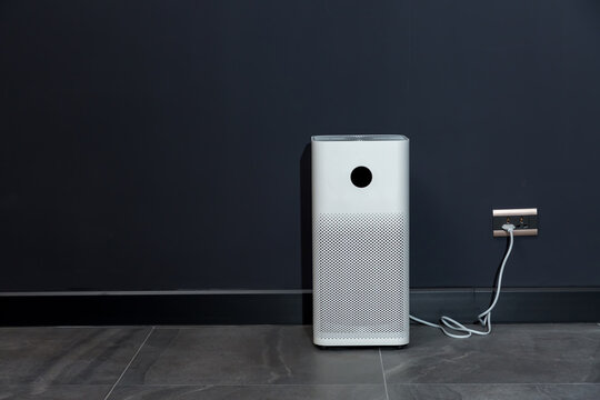Air purifier in room for filter and cleaning removing dust PM2.5 . Air purifier in home for fresh air and healthy life, Air Pollution Concept