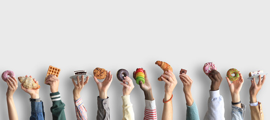 People are holding different desserts in their hands. The concept of food and sweets.