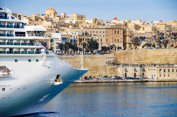 Modern Costa cruiseship or cruise ship liner departure from Valletta on Malta island with panoramic scenic view of historic old town, city walls and fortress skyline on summer day during Med cruising