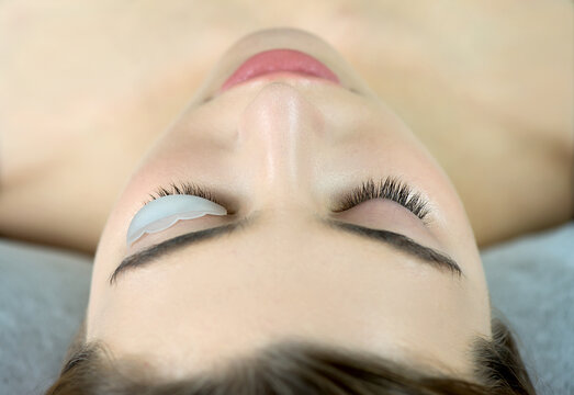 Close up of beauty model's face with perfect fresh skin and long eyelashes, lash lift laminate botox procedure.
