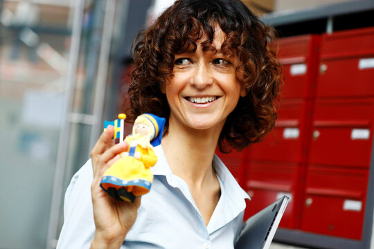 Scientist Emmanuelle Charpentier, director of the Max Planck Institute for Infection Biology in Berlin holds a swedish themed puppet after winning the 2020 Nobel Prize in Chemistry for the development of a method for genome editing, in Berlin