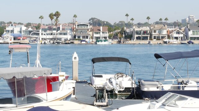 Newport beach harbor, weekend marina resort with yachts and sailboats, Pacific Coast, California, USA. Waterfront luxury suburb real estate in Orange County. Expensive beachfront holiday destination
