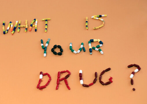 Text design made of medicine pills by Egyptian artist Salah is seen in Cairo