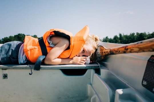 young girl sleeping on a boat in Sweden in summer