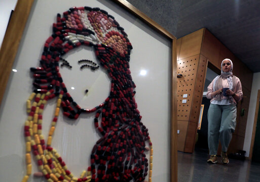 Artwork made of medicine pills by Egyptian artist Salah is seen in Cairo
