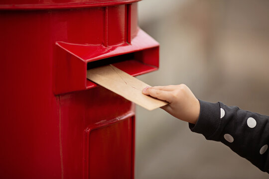 Hand holding envelope. Voting by Mail for absentee ballot or mail-in voting in the presidential election during coronavirus covid-19 pandemic