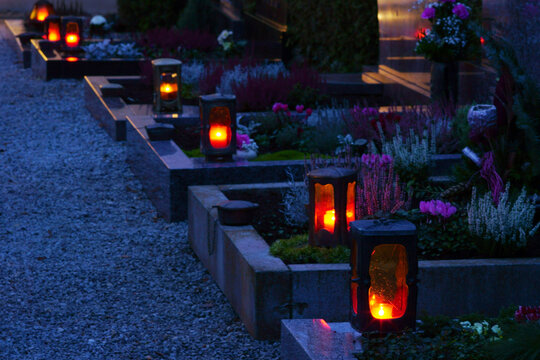 Graves with grave lights on evening, copy space