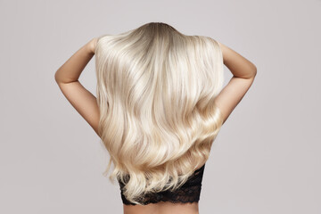 wavy blond hair back view