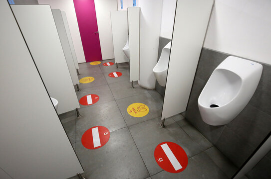 Social distancing stickers are seen on the floor of a mens's toilet at the Arenas de Barcelona shopping mall (a former bullring) during the coronavirus disease (COVID-19) outbreak in Barcelona