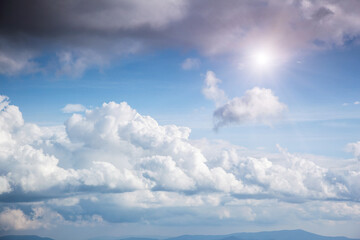 Wall Mural - Fantastic view of the azure sky on a sunny day with fluffy clouds.