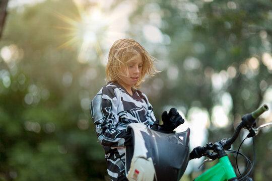 Kid with helmet and bike