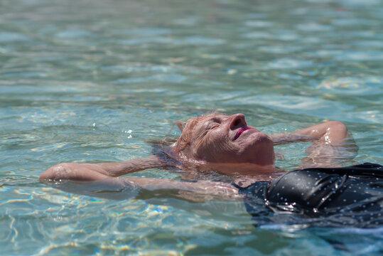 senior woman floating in water