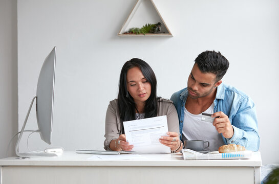 Young couple stressing over credit card debt