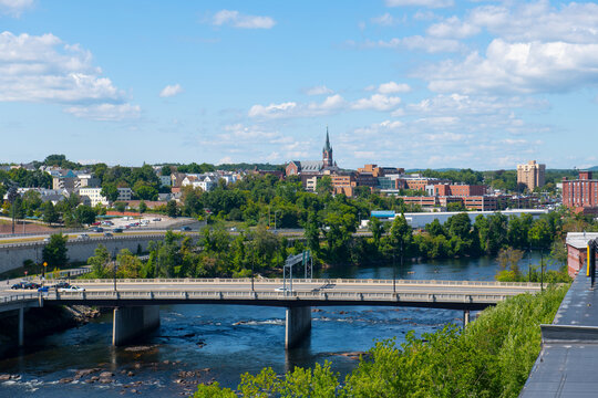 Manchester historic city skyline including Merrimack River, Granite Street Bridge and West Side Sainte Marie Parish church in Manchester, New Hampshire NH, USA.