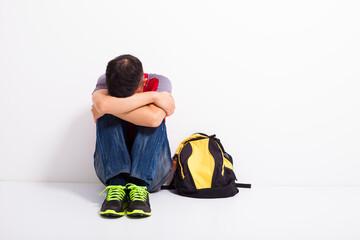 Fototapeta terrified student  sitting on the floor  obraz