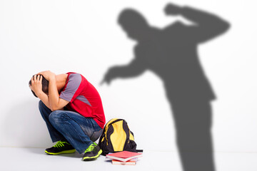 Fototapeta  Man shadow attack   to terrified student with a fist  obraz