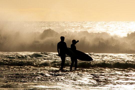 Silhouette of Surfers in Ocean