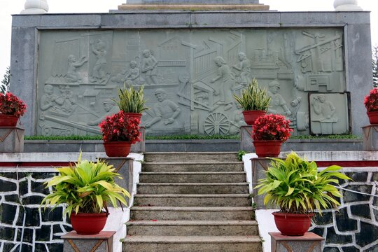 Hoi An, Vietnam, February 29, 2020: Stairs leading to one of the relief murals commemorating the Vietnam War in the Hoi An Martyrs Cemetery.