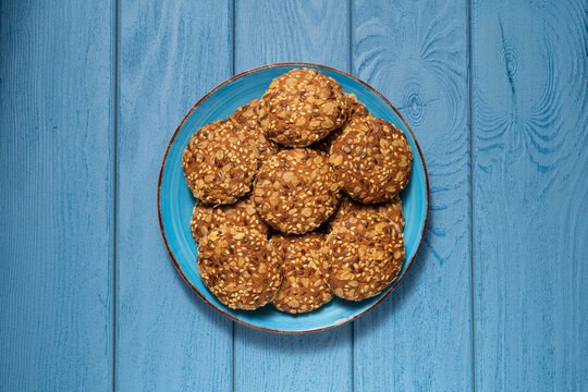 TOP VIEW: Oatmeal cookies on a blue plate on a blue table