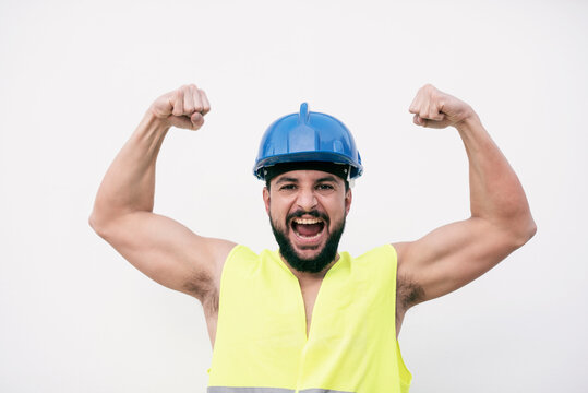 Stressed construction worker posing with raised arms angry on white background