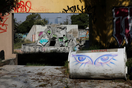 Urban graffiti on the remains of an abandoned dolphin show center, are seen inside the Bosque de Chapultepec as part of the project where Mexican artist, Gabriel Orozco will design, in Mexico City