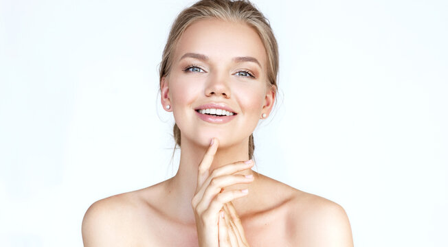 Beautiful young woman with clean fresh skin on face . Girl facial  treatment   . Cosmetology , beauty  and spa .
