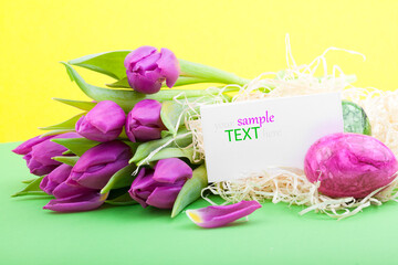 easter eggs and tulips and blank for text