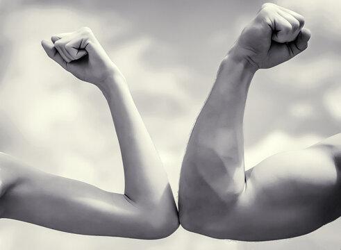 Muscular arm vs weak hand. Vs, fight hard. Competition, strength comparison. Rivalry concept. Rivalry, vs, challenge, strength comparison.