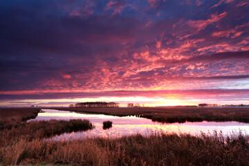 fire dramatic sunrise over river